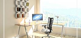 Cadeira de oficina diante dun escritorio cun ordenador persoal.